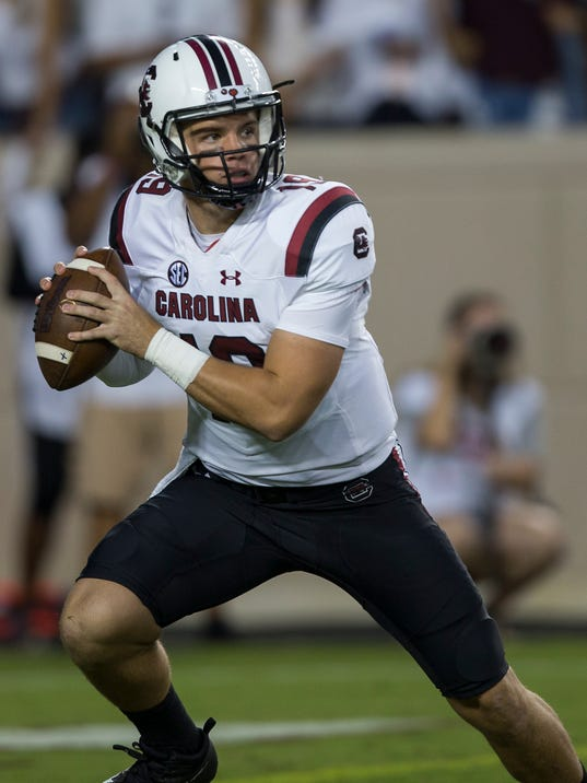 FILE - In this Sept. 30, 2017, file photo, South Carolina quarterback Jake Bentley (19) looks to pass down field against Texas A&M during the first quarter of an NCAA college football game, in College Station, Texas. After getting a firsthand look at how a quarterback switch caused South Carolina to heat up late last season, Tennessee is hoping its own shake-up provides a similar spark. South Carolina was 2-4 last season when the Gamecocks abandoned plans to redshirt Jake Bentley and moved the freshman to the top of their depth chart. Tennessee now wants to flip the script, as redshirt freshman Jarrett Guarantano makes his first career start Saturday when the Volunteers host the Gamecocks.(AP Photo/Sam Craft, File)