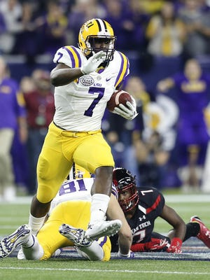 LSU Tigers running back Leonard Fournette (7) rushes against the Texas Tech Red Raiders in the first quarter at NRG Stadium.