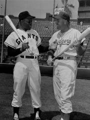 Giants center fielder Willie Mays (left) jokes with the Dodgers' Duke Snider prior to the teams' first game in California, on April 15, 1958, at Seals Stadium in San Francisco.