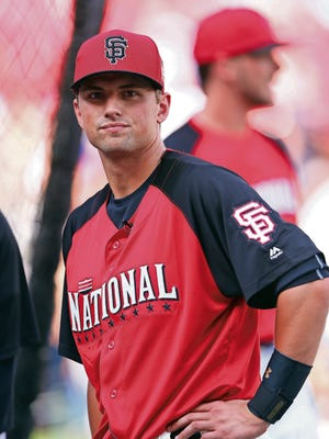 CINCINNATI, OH - JULY 13:  National League All-Star Joe Panik #12 of the San Francisco Giants looks on during the Gatorade All-Star Workout at the Great American Ball Park on July 13, 2015 in Cincinnati, Ohio.  (Photo by Elsa/Getty Images)