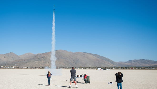 Members of Reno Rocketry watch a high-powered rocket launch in Cold Springs in October.
