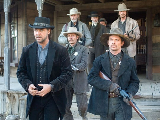 "Russell Crowe, left, Chad Brummett, front right, Luce Rains, middle left, Peter Fonda, back left,Christian Bale, back right, and Lennie Loftin, back center in a scene from the motion picture ""3:10 to Yuma."" Photo by Richard Foreman, Lionsgate Films (Via MerlinFTP Drop)"