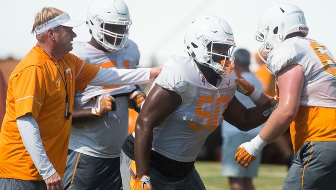 Vols offensive linemen, from left, Drew Richmond (51) and Venzell Boulware (50) with offensive line coach Walt Wells at practice on Sunday, Aug. 6, 2017.