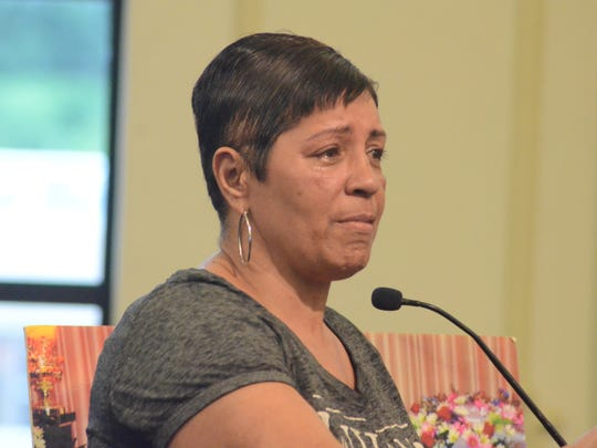Rosetta Brewer cries as she speaks about the shooting