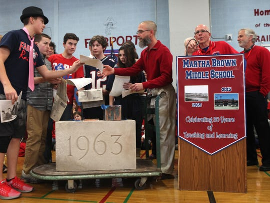 Students and faculty celebrate the 50th Anniversary of Martha Brown Middle School in Fairport with the opening of a time capsule that was in the cornerstone of the building.