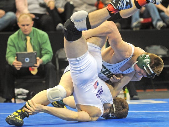 Edgar senior Devin Lemanski, right, won the Division 3 state championship at 170 pounds at the WIAA state tournament. He also won as a sophomore at 126 pounds. For his efforts this season he was named Gannett Central Wisconsin Media co-wrestler of the year.