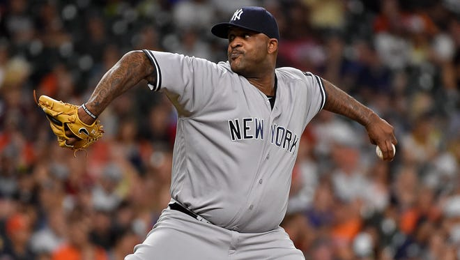 New York Yankees starting pitcher CC Sabathia winds up during the third inning of a baseball game against the Houston Astros, Tuesday, July 26, 2016, in Houston.