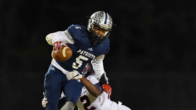 Powdersville's EJ Humphry escapes the tackle attempt by Chester's Kenny Agurs. Chester plays at Powdersville in a Class AAA second-round playoff game Friday, Nov. 25, 2016.