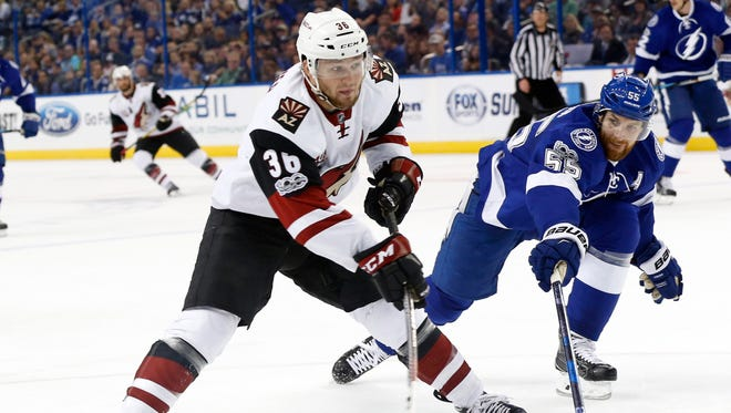 Mar 21, 2017: Arizona Coyotes right wing Christian Fischer (36) passes the puck as Tampa Bay Lightning defenseman Braydon Coburn (55) defends during the first period at Amalie Arena.