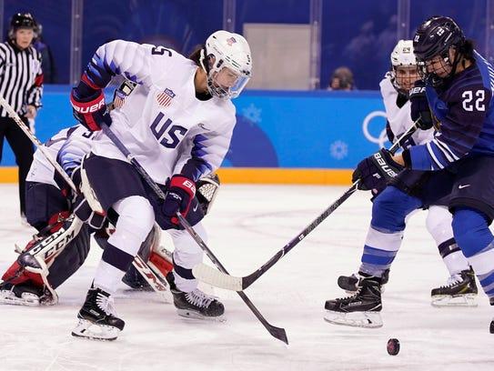 Megan Keller, of USA women's hockey, in action against