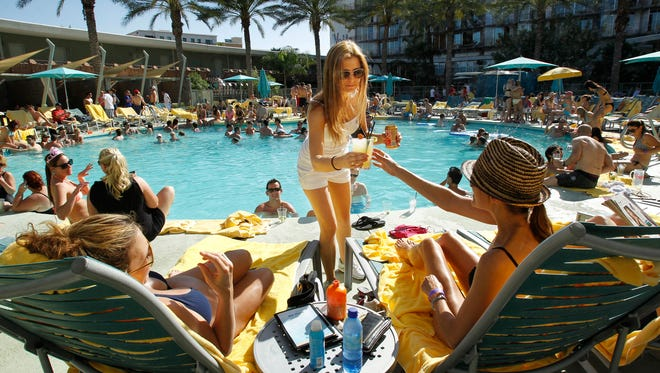 Server Tess Pekrul brings drinks to guests sitting by the pool at Hotel Valley Ho in Scottsdale. The hotel had its best March yet in occupancy, according to its sales and marketing director.  David Kadlubowski/ABG Server Tess Pekrul serves drinks to guests at the pool Saturday, April 28, 2012 at Hotel Valley Ho in Scottsdale. Scottsdale tourism has seen some growth recently.