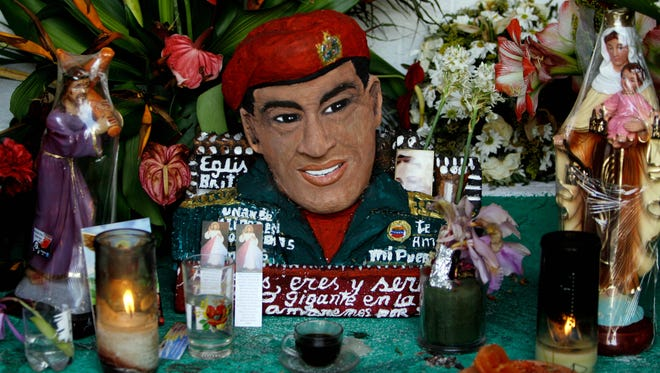 A 2013 file photo shows a bust of the late   Hugo Chavez.