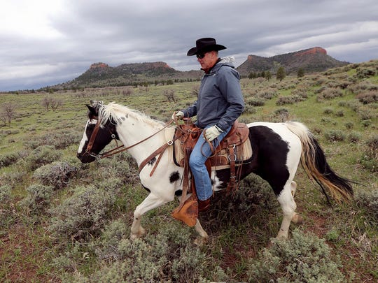 "In this May 9, 2017, file photo, Interior Secretary Ryan Zinke rides a horse in the new Bears Ears National Monument near Blanding, Utah. Zinke has closely followed his boss' playbook, encouraging mining and drilling on public lands and size reductions for national monuments that President Donald Trump said were part of a ""massive land grab."" Yet Zinke's made an exception in his home state of Montana."