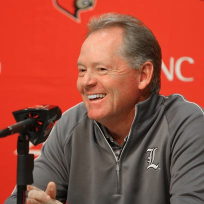 UL coach Bobby Petrino speaks to the media during his