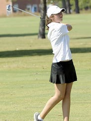 Central Magnet's Delaney Sain watches her shot during