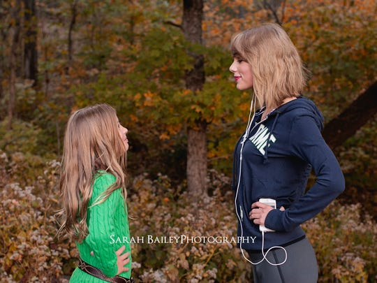 Taylor swift surprises a young fan during a photo shoot with photographer Sarah Bailey at Warner Park on Sunday Nov. 2, 2014.