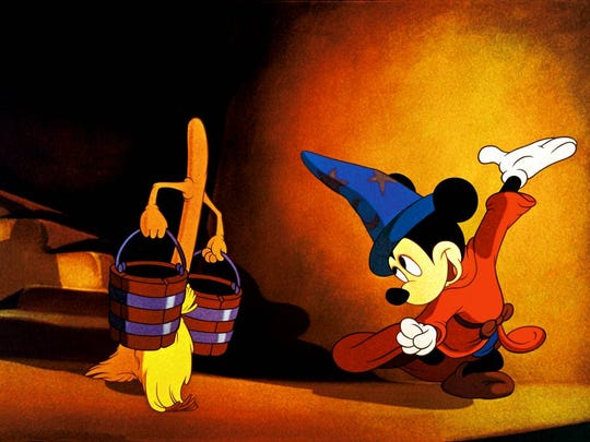 """Mickey Mouse and his co-star in """"The Sorcerer's Apprentice."""""""