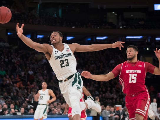 MSU's Xavier Tillman fights for a loose ball during MSU's Big Ten tournament win over Wisconsin.