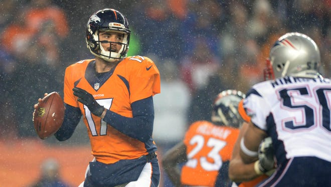 Denver Broncos quarterback Brock Osweiler (17) prepares to pass the ball in the first quarter against the New England Patriots at Sports Authority Field at Mile High.