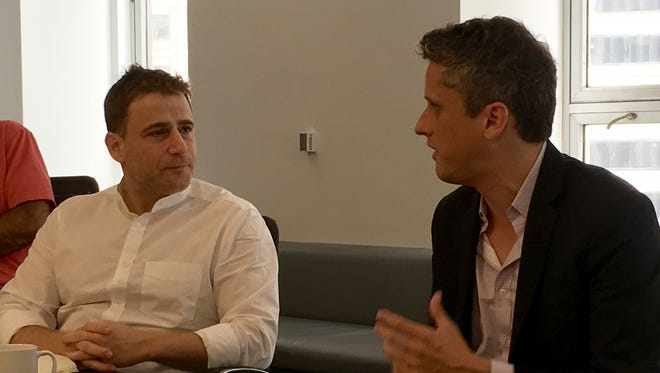 Stewart Butterfield (left), CEO of Slack, talks about the future of work with Box CEO Aaron Levie.