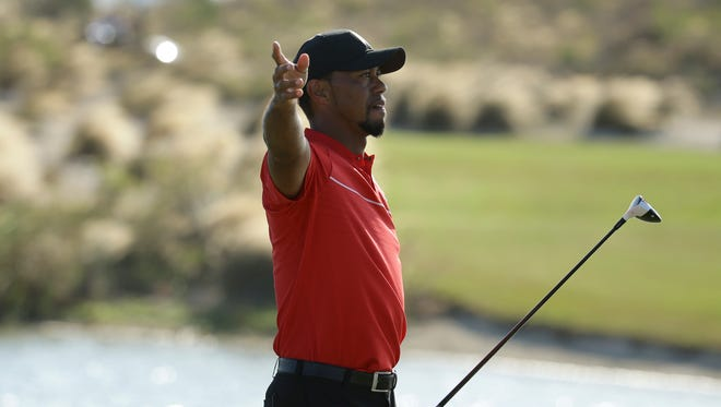 Tiger Woods motions that his ball went right after teeing off on the 18th hole during the final round at the Hero World Challenge  on Dec. 4 in Nassau, Bahamas.