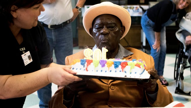 Floyd Simmons blows out the candles on his birthday cake to celebrate turning 102 with family, staff and other residents of the Northeast Louisiana Veterans Home on Tuesday, March 28, 2017. Simmons served in the Army during World War II. He was based in the Philippines and served from 1941 to 1945.