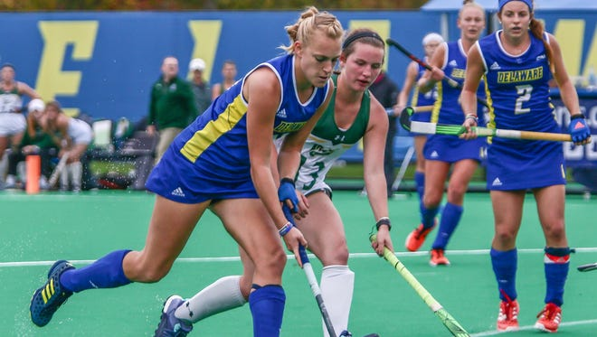 Delaware forward Greta Nauck (21) advances the ball downfield as Ella Donahue (13) defends in the second half of the CAA field hockey finals in 2017.