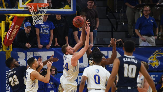 SDSU's Mike Daum tries to gain control of the ball over Oral Roberts' Chris Miller during the game Thursday, Dec. 11. in Brookings.