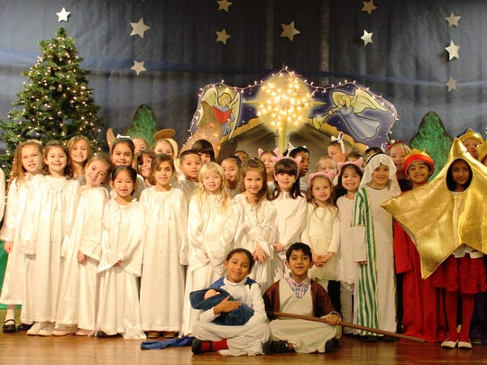"""St. Francis Cathedral first- and second-grade students performed their annual Christmas program, """"The Tale of the Drowsy Shepherd,"""" on Dec. 13 in Metuchen. The Drowsy Shepherd (sixth from right) is James Adams and in the center are Natalia Rosario (Mary) and Sean D'Mello (Joseph). The children sang, danced and re-created the story of the first Christmas in the eyes of a shepherd boy."""