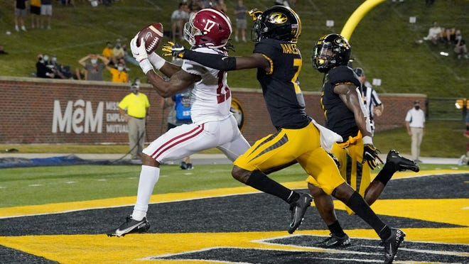 Alabama wide receiver Jaylen Waddle (17) catches a pass for a touchdown against Missouri defensive back Ennis Rakestraw Jr. (2) during a Southeastern Conference game on Saturday night at Faurot Field.