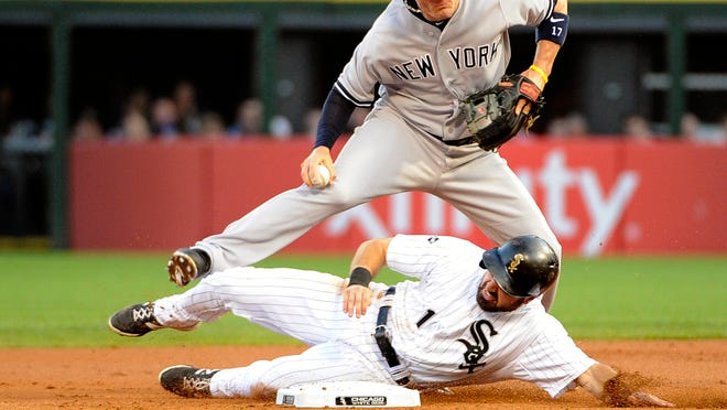 Yankees shortstop Brendan Ryan forces out White Sox center fielder Adam Eaton during the first inning.