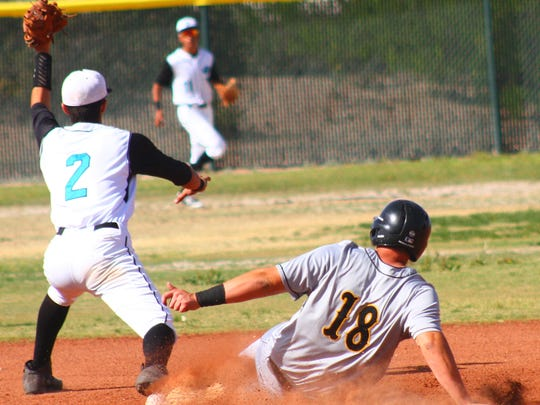 Alamogordo senior Thompson Rick slides into second base safely Thursday afternoon.