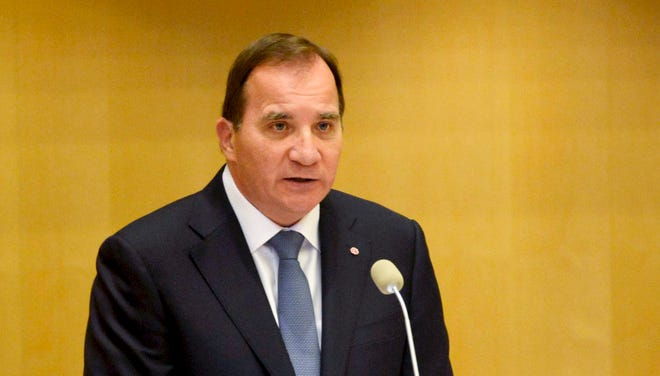 Sweden's new prime minister, Stefan Lofven, announces his government in the Swedish Parliament in Stockholm Friday.