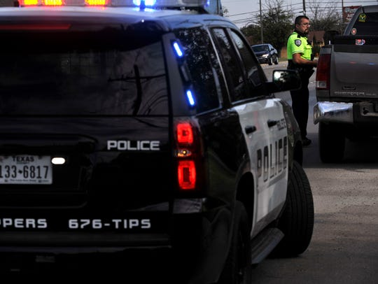 Abilene Police Department traffic officer Michael Garcia speaks with a motorist before issuing a citation Nov. 18 during a traffic stop on South 27th Street.