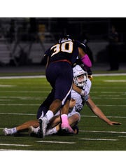 Wylie High School linebacker Anthony Guerrero pushes
