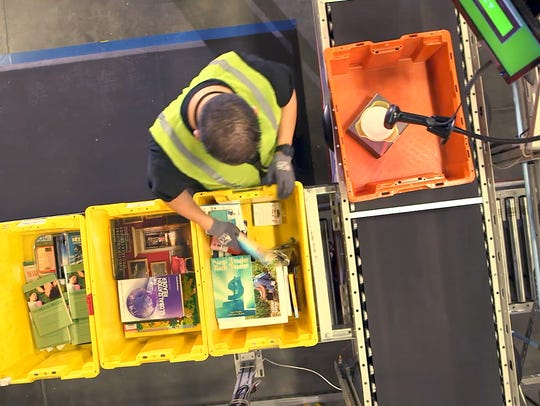 A worker gathers an customer order at a fulfillment