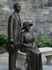 The life-size bronze sculpture of Henry and Clara Ford sits in the Early Rose Garden at Fair Lane, the historic home of the pair, in Dearborn.