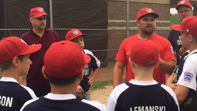 Wausau National coach Jeremy Jirschele, center, talks to his players before the Little League team's practice Wednesday at Doepke Park.
