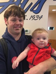 Todd Madson brought his 8-month-old son, Colton, to a campaign rally Monday morning for Democratic gubernatorial candidate Mahlon Mitchell at Al's Hamburgers in Green Bay.