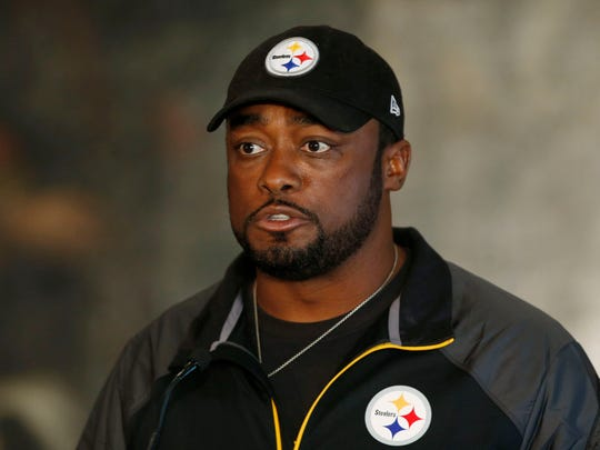 Pittsburgh Steelers' head coach Mike Tomlin speaks to the media, during a press conference in central London, Friday, Sept. 27, 2013.