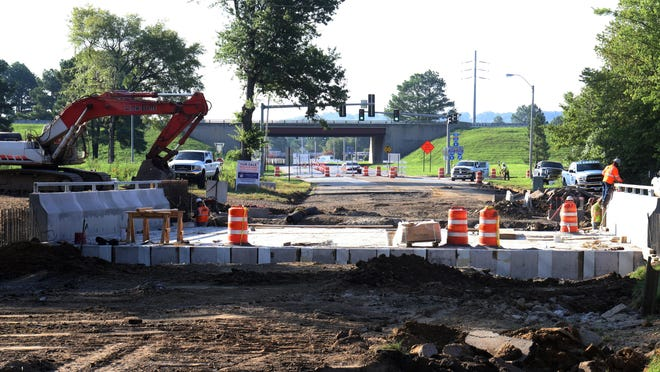 Work continues on replacing the Jenny Lind Rd bridge at I-540, Thursday, August 6, 2020, as part of the work by Mobley Contractors on the streets from Harvard Drive to Market Trace. The removal and replacement of the bridge over Mill creek started mid-June with a completion date of August 1, 2020.