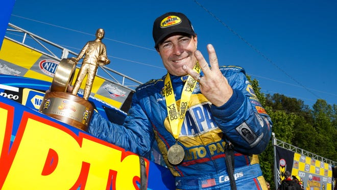 NHRA Funny Car driver Ron Capps celebrates after winning the Southern Nationals at Atlanta Dragway.