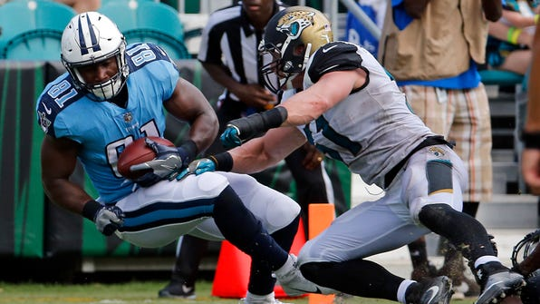 Tennessee Titans tight end Jonnu Smith (81) crosses the goal line past Jacksonville Jaguars middle linebacker Paul Posluszny for a touchdown on a 32-yard pass play during the second half of an NFL football game, Sunday, Sept. 17, 2017, in Jacksonville, Fla. (AP Photo/Stephen B. Morton)