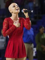 Dani Dease singing the national anthem
