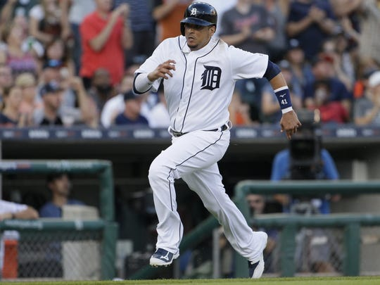Tigers designated hitter Victor Martinez scores from