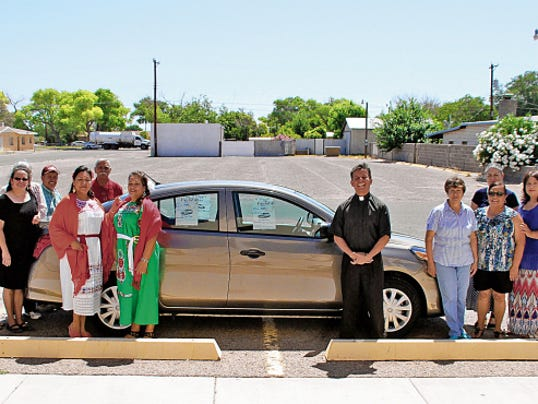 Volunteers and members of the St. Ann Catholic Church Fiesta Committee gathered in front of the 2015 Nissan Versa they will giveaway at 3 p.m. on Sunday, June 28, at Luna County Courthouse Park. Tickets for the car raffle are 25 and can be purchased at St. Ann Church, 400 S. Ruby St. The 66th annual St. Ann Fiesta and Barbecue is June 27-28 at courthouse park.