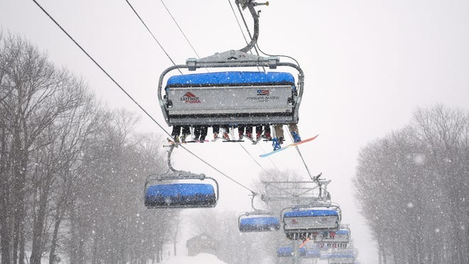 """Mount Snow's Bluebird Express lift was installed in 2011. The chairs have been nicknamed the """"flying sofas"""" because of their comfort."""