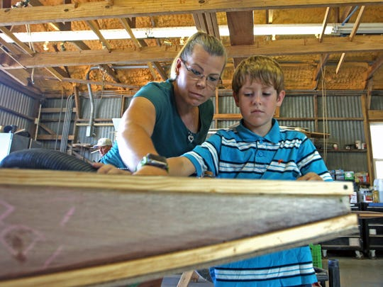 Mason McKittrick, 8, and his mom, Kimberley McKittrick, teamed up with Mason's brother, Matthew, not pictured, to create a boat.