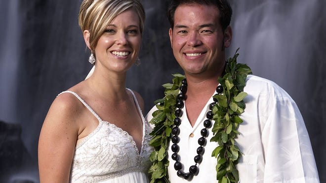 "FILE - This 2008 file image released by TLC, shows Jon Gosselin, right, and his wife Kate Gosselin, from the TLC series ""Jon & Kate Plus 8,"" in Hawaii. Kate Gosselin has filed a lawsuit accusing her ex-husband, Jon, of stealing her hard drive and hacking into her phone and computer to get material for a tell-all book. The federal lawsuit says he took the material for a book called ""Kate Gosselin: How She Fooled the World."" The suit, filed Monday, Aug. 26, 2013, in Philadelphia, says the book was written by her ex-husband's friend, tabloid writer Robert Hoffman, but has since been pulled from Amazon because the material was obtained illegally. (AP Photo/TLC, Mark Arbeit) ORG XMIT: NYET901"