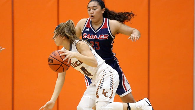 Alice's Criselda Cruz looks to pass against Veterans Memorial during the 30-5A girls InterZone playoff game on Friday, Feb. 10, 2017, at Alice High School in Alice.